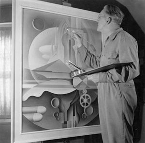Bertram Brooker - Brooker painting in his studio, 1943