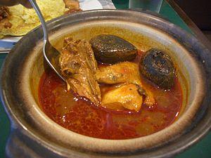 Peranakan cuisine - Chicken with keluak