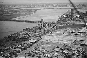 East Perth Power Station - East Perth Power Station at the centre of this 1930 photograph.  Bunbury Bridge crosses the river and East Perth Gasometer is in the top right.