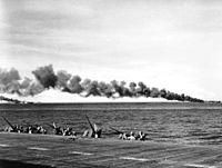 Burning carriers USS Franklin (CV-13) and Belleau Wood (CVL-24) as seen from Enterprise (CV-6) 1944.jpg