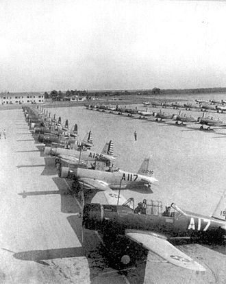 "Augusta Regional Airport - Vultee BT-13 and BT-15s at Bush Field. The initial ""A""s on the fuselages were assigned for Bush Field aircraft."