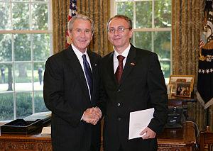 Zoran Jolevski - Jolevski with George W. Bush exchanging letters of credence.