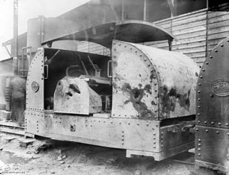 War Department Light Railways -  Western Front (Belgium), Ypres Area, Poperinghe. A 40 hp Simplex petrol locomotive that was damaged by shellfire and returned to the railway yard for repairs