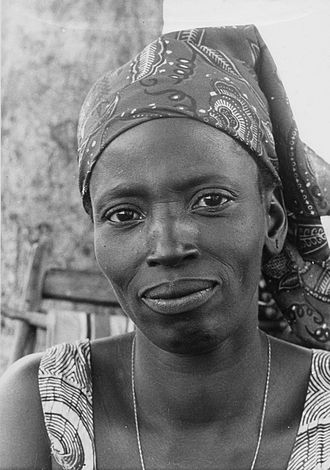 Dyula people - Photo of a Dyula farmer wearing a Dutch wax headscarf, 1966.