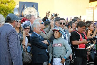 Victor Espinoza - Espinoza (in gray silks) with Art Sherman before the 2016 Breeders' Cup Classic