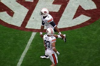 Cam Newton - Newton (top) warming up prior to the 2010 Iron Bowl