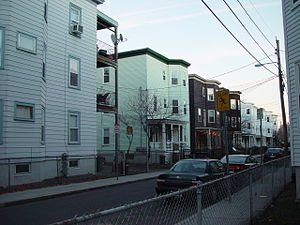 Three-decker (house) - A row of flat-roofed triple deckers in Cambridge, Massachusetts