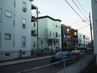 Cambridgeport, Cambridge, Massachusetts - A row of flat-roofed triple deckers in Cambridge, Massachusetts