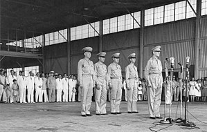 Philippine Army Air Corps - Ceremony at Camp Murphy in Rizal marking the induction of the Philippine Army Air Corps into the U.S. Army on 15 August 1941. Behind Lt. Gen. Douglas MacArthur, from left to right, are Lt. Col. Richard K. Sutherland, Col. Harold H. George, Lt. Col. William F. Marquat, and Maj. LeGrande A. Diller.