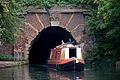 Canal boat and tunnel under Muriel Street, London.jpg
