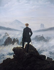 Painting of a man standing with his back to the viewer. He is atop a mountain and surrounded by clouds and fog. He is dressed in black and contrasts sharply with the whites, pinks, and blues of the atmosphere. In the distance outcroppings of rocks can be seen.