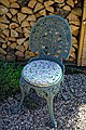Cast iron garden chair at Boreham, Essex, England.jpg