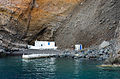 Chapel in the crater rim at the sea level seen from the caldera - Santorini - Greece.jpg