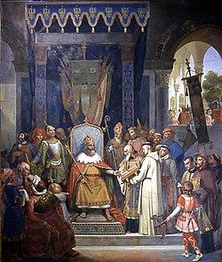 Charlemagne, entouré des ses principaux officiers, reçoit Alcuin qui lui présente des manuscrits, ouvrage de ses moines.