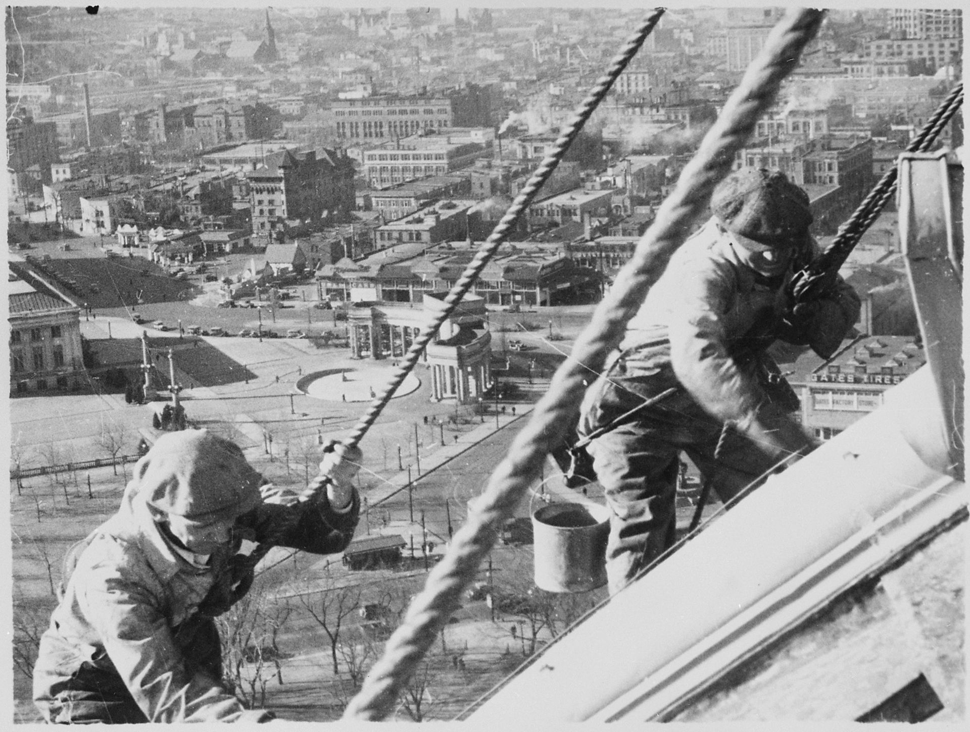 Civil Works Administration workers cleaning and painting the gold dome of the Colorado State Capitol (1934)