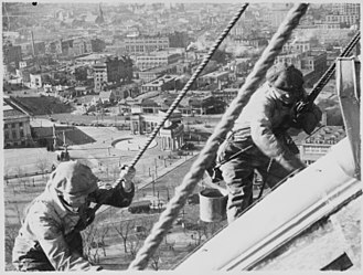 Civil Works Administration - Civil Works Administration workers cleaning and painting the gold dome of the Colorado State Capitol (1934)