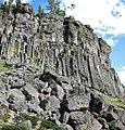 Columnar-jointed rhyolitic obsidian lava flow (Roaring Mountain Member, Plateau Rhyolite, Upper Pleistocene, ~59 ka; Obsidian Cliff, Yellowstone, Wyoming, USA) 5 (46817937031).jpg