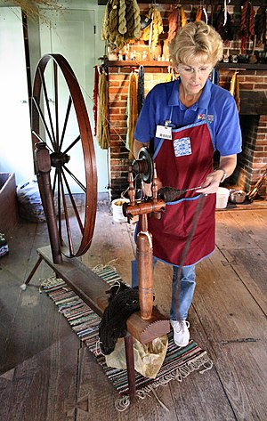 Spinning wool on a great wheel at a demonstrat...