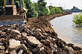Contractor places rock on temporary levee.jpg