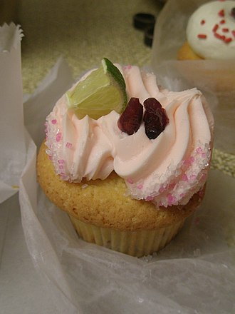 Cosmopolitan (cocktail) - A cosmo-flavored cupcake with lime, vodka, lime juice soaked cranberries, lime buttercream on vanilla cake from Dozen Bake Shop in Pittsburgh.