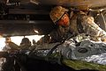 Cpt. Drew Webb works with Indian and U.S. Army personnel to safely loading a simulated casualty into an Indian Army helicopter.jpg