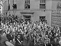 Crowds of people gathered ouside the General Assurance Corporation building in St Peter Port, Guernsey to welcome the British Task Force sent to liberate the island from German occupation, 10 May 1945. D24590.jpg