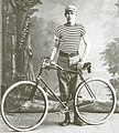 Cyclist-with-bicycle-in-russian-empire.jpg