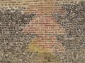 Détail motif brique dans soubassement en silex.png