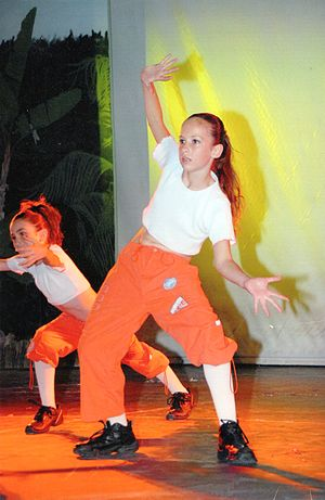 girl dancing wearing the fashions of 2006