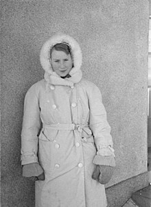 A Danish volunteer physician, wearing heavy winter clothing, is looking straight into the camera.