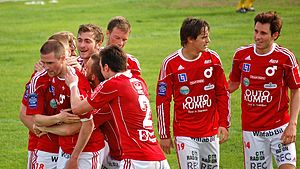 Degerfors IF - The Degerfors team celebrating a 2010 Superettan goal while wearing their traditional red and white home kit.