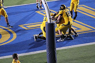 2010 California Golden Bears football team - Cal nose guard Derrick Hill scores on a fumble recovery.
