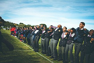 """Port Alfred High School - A group of Port Alfred High School students cheering for the first team rugby players using their war cry """"die leeu"""" (the lion)"""
