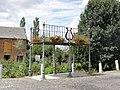 Dimechaux (Nord, Fr) la Place avec calvaire et kiosque à musique.jpg