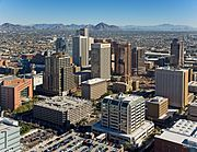 tall buildings of downtown Phoenix, with the mountains to the north in the background, centering on Camelback mountain.
