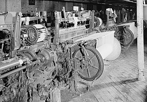Northrop Loom - A Draper loom showing a Northrop filling-changing battery (the cylinder of pirns) in Bamberg, South Carolina