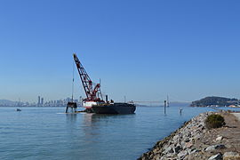 Dredge in the Port of Oakland with San Francisco in the background