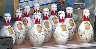 Duckpin bowling - Duckpins are shorter and squatter than the pins used in 10-pin bowling.