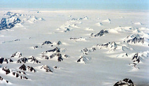 Glacial survival hypothesis - Nunatak mountains at the east coast of Greenland in the Amassalik area. Seen from 15.000ft altitude. July 1996, by Michael Haferkamp