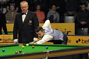 Mark Selby playing a shot