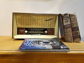 The Historians' History of the World - Two volumes of The Historians' History of the World on a shelf next to an old radio set