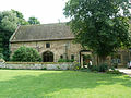 Ely - the monastery's 14th C storage barn - now school buildings.JPG