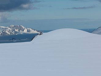 Erma Knoll - Erma Knoll from near Camp Academia, with McFarlane Strait and Greenwich Island in the background
