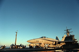 An F/A-18A Hornet of VFA-161 prepares to launch from USS Enterprise while an F-14A waits behind. CVW-10 was onboard Enterprise in 1987.