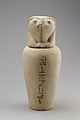 Falcon-headed stopper (Qebehsenuef) from a canopic jar MET 28.3.116a b EGDP019908.jpg