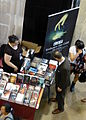 Fan Expo 2014 - Ted Raimi at a booth (14951229029).jpg