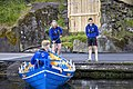 Faroese rowers and their boat. Photo by Ólavur Frederiksen, July 19, 2021.jpg