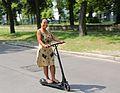 Female rider on Egret One eScooter.jpg