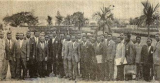 Lumumba Government - Prime Minister Patrice Lumumba (left center, wearing bow tie) with his government outside the Palais de la Nation following its investiture
