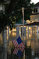 Flag dipping in water on a porch in Cedar Rapids Iowa.jpg